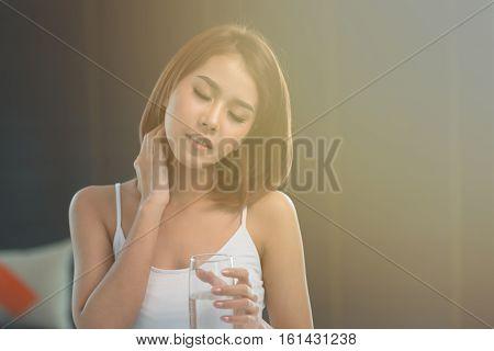 Portrait of asian woman with migraine,Feeling headache.