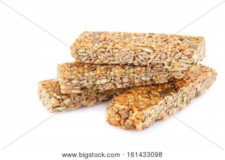 Cereal bars with different seeds isolated on white background.