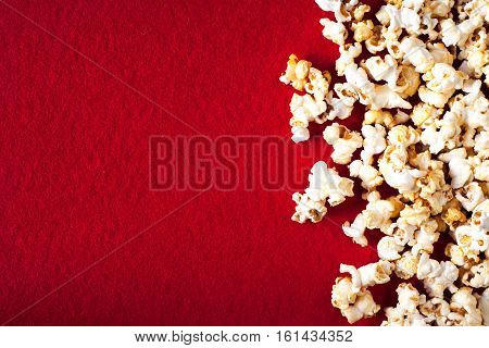 Popcorn popcorn on red textured background close up macro