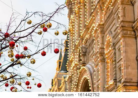 Streets Fully Decorated For Christmas With Red And Gold Balls. Christmas Tree In The City. House Ill