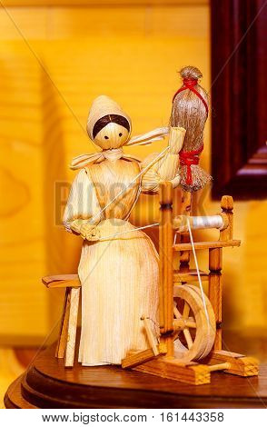 folk style traditional handmade figure made from natural materials doing chores and crafts
