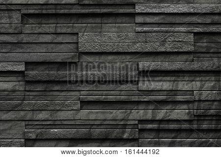 Black crumpled bricks slate texture background, slate stone wall texture
