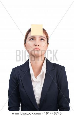 A Portrait Of A Young Confused Business Woman With A Sticky Note On Her Forehead
