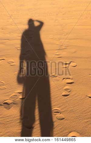 Shadow On The Ground In Desert