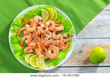 Shrimp Tails On Bed Of Lettuce And Lemon Sllices