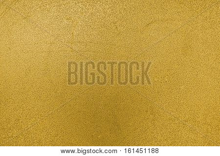 Metal, metal background, metal texture. Yellow metal texture, yellow metal background. Abstract metal background.