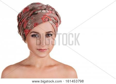 portrait of white-skinned girl in a turban. caucasian woman with freckles. Isolated on white background