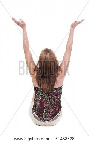 Back view of Beautiful woman in shorts looking at wall and Holds  hand up.  young blonde girl sitting on floor. Rear view people. Isolated over white background.