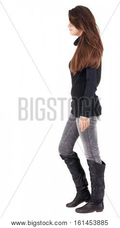 back view of walking  woman  in  gray jeans. beautiful brunette girl in motion.  backside view of person.  Rear view people collection. Isolated over white background.