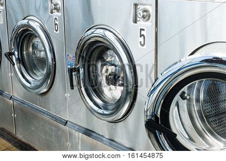 Business of industrial laundry machines in launderette store
