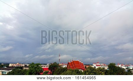 Landscape of rural city with red roof temple and cloudy sky Udonthani Tailand