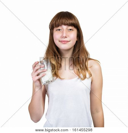 Happy smiling teen girl drinking milk over white background.