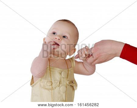 Little girl portrait. The child holds onto a woman's hand finger. The baby was conceived