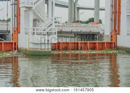 The Khlong Lat Pho Floodgate Project, Thailand. Foreign text behind floodgate is the name