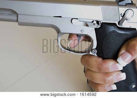 Female Hand Gripping Gun