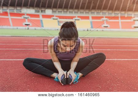 Close Up Of Fit Body Of Sport Girl She Warming Up Before Running