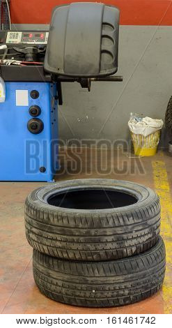 Various tools and stuff in a tire fix workshop and a diplay of balancing machine