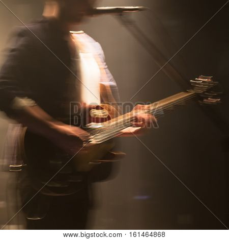 Blurred Electric Guitar Player