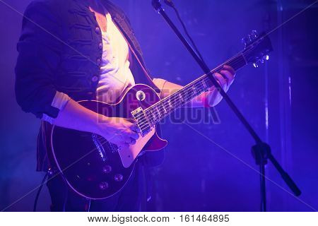 Electric Guitar Player In Blue Light