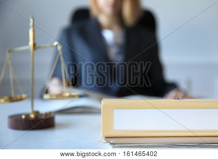 Folder on lawyer table, closeup