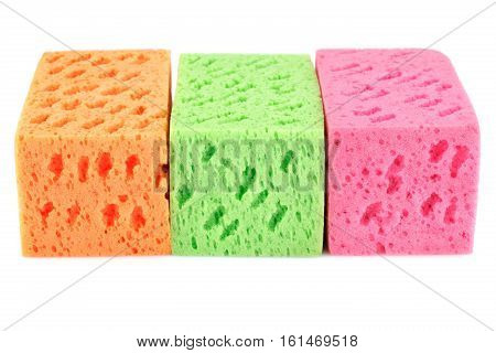Three colorful sponges isolated on white background.