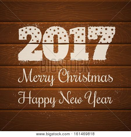 Vector poster for new year and Christmas. 2017 on wooden background.
