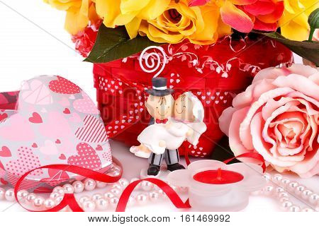 Colorful roses bride and fiance candle and gift box close up picture.