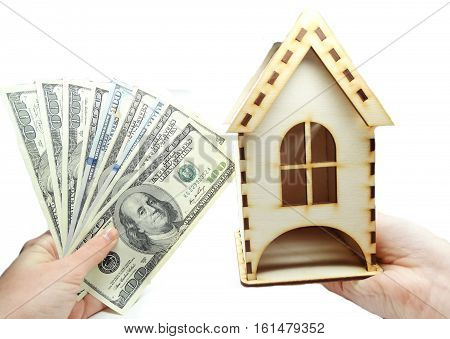 house model on hand dollars cash money real estate concept