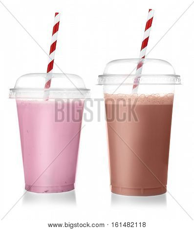 Tasty milk cocktails in plastic cups isolated on white