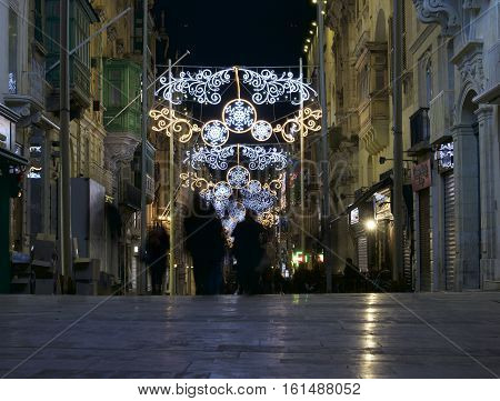 VALLETTA MALTA - DEC 8, 2016: view of illuminated Republic Street with christmas decoration in Valletta, Malta. Christmas decoration in Valletta, Malta, Europe