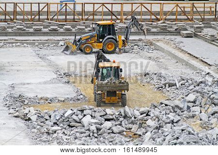 Volgograd Russia - June 24 2014: Bulldozers with pneumatic hammers and buckets crush and clear the site of concrete under construction on the Mamaev Kurgan in Volgograd