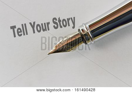 Closeup of the nib of a fountain pen and text Tell Your Story