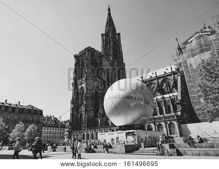 STRASBOURG FRANCE - MAY 4 2016: Cathedral Notre-Dame and urban pavilion in central square installed to promote the candidacy of France for the organisation of the World Fair 2025