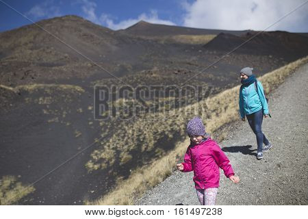 People hiking Etna crater and volcanic landscape around mount Etna Sicily Itlay