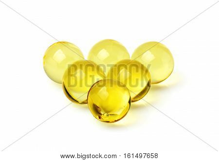 Fish oil capsules isolated on a white background.