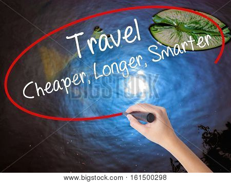 Woman Hand Writing Travel Cheaper Longer Smarter  With Marker Over Transparent Board