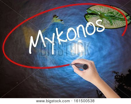 Woman Hand Writing Mykonos With Marker Over Transparent Board