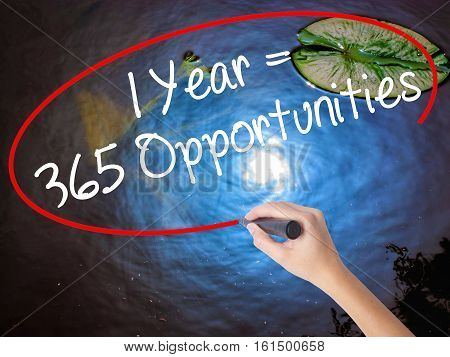 Woman Hand Writing 1 Year = 365 Opportunities With Marker Over Transparent Board