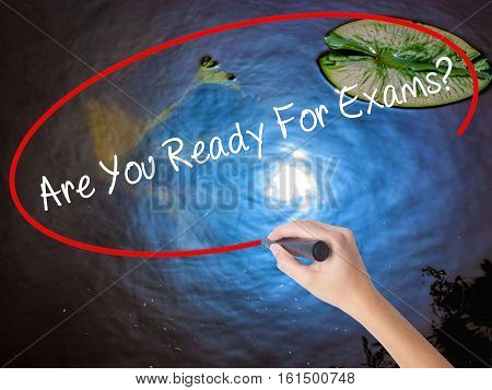 Woman Hand Writing Are You Ready For Exams? With Marker Over Transparent Board