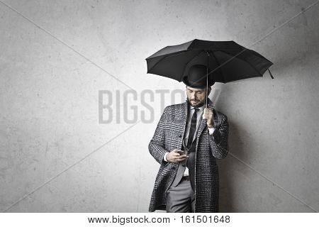 Bussinesman with umbrella