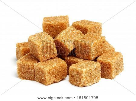 Cane sugar cubes isolated on a white background.