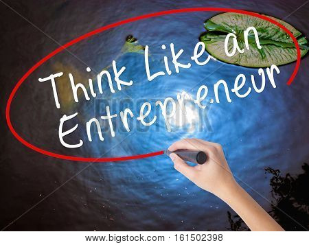 Woman Hand Writing Think Like An Entrepreneur With Marker Over Transparent Board