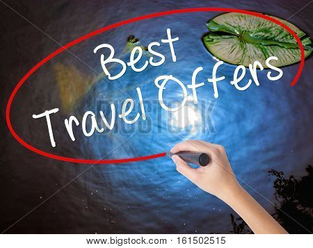 Woman Hand Writing Best Travel Offers  With Marker Over Transparent Board