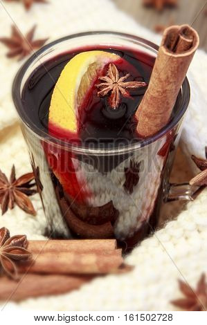 Mulled wine with spices and white cotton backgroung