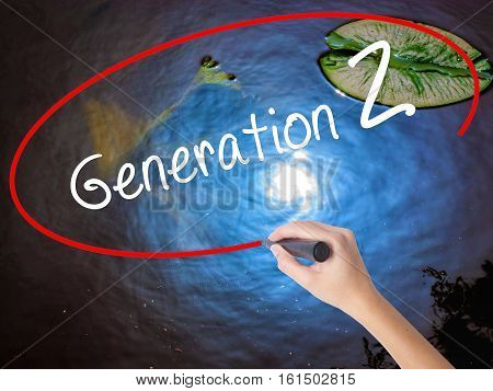 Woman Hand Writing Generation Z With Marker Over Transparent Board