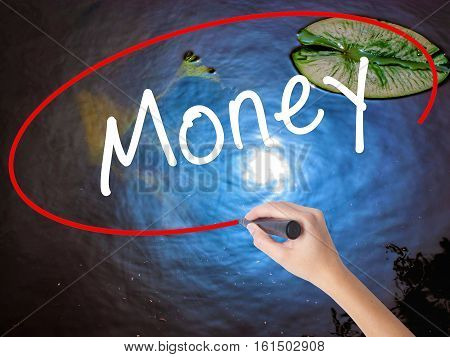 Woman Hand Writing Money With Marker Over Transparent Board