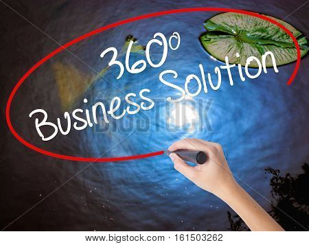 Woman Hand Writing 360 Business Solution With Marker Over Transparent Board