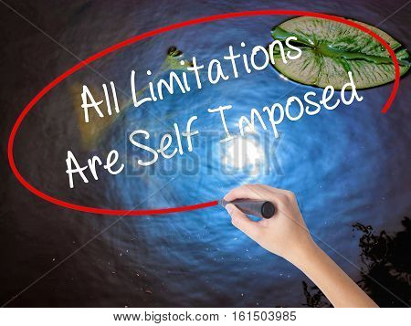 Woman Hand Writing All Limitations Are Self Imposed With Marker Over Transparent Board