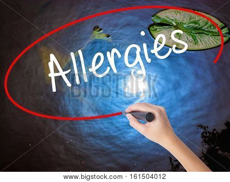 Woman Hand Writing Allergies With Marker Over Transparent Board
