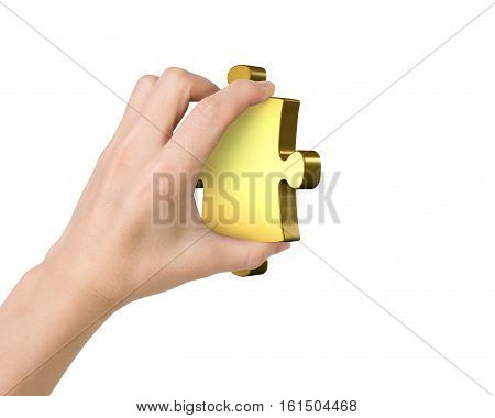 Hand holding one golden puzzle piece isolated on white.